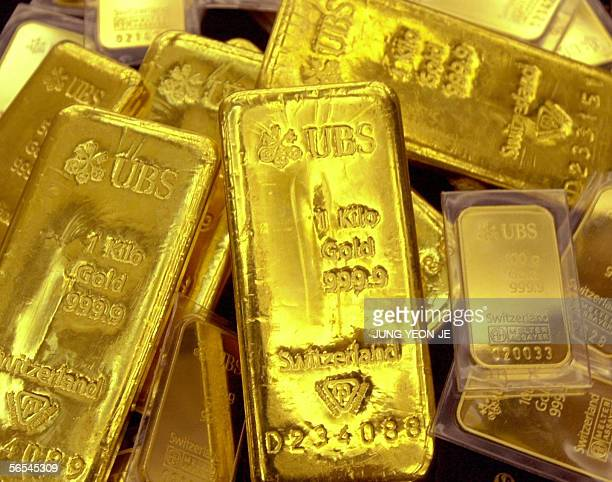 Gold bars are displayed at Shinhan Bank in Seoul on 09 January 2004 Gold prices hit 54460 dollars per ounce on January 09 the highest level since...