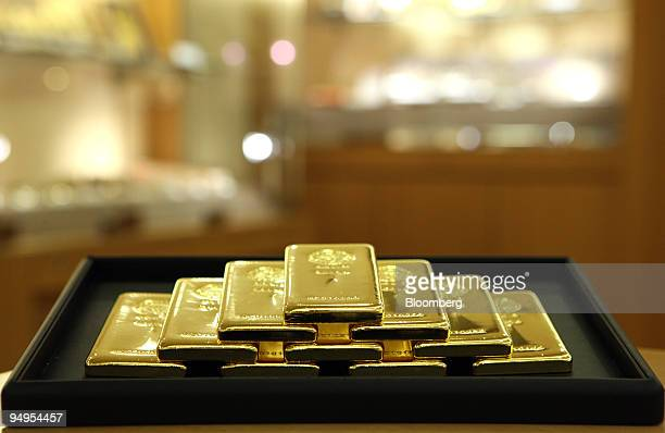 Gold bars are displayed for a photograph at Tanaka Kikinzoku Jewelry K K's store in Tokyo Japan on Tuesday Sept 8 2009 Gold rose to the highest price...