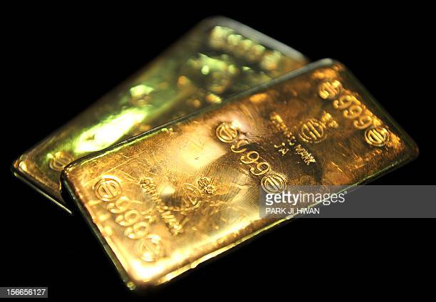 Gold bars are seen at a jewellery shop in Seoul on September 27 2011 Gold tumbled below 1600 USD an ounce in Hong Kong trade on September 26 despite...