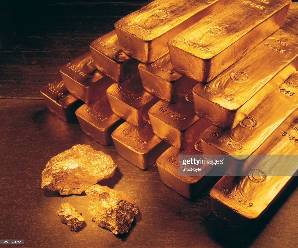 Gold bars, coins and raw nuggets : Stock Photo