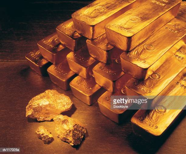 Gold bars, coins and raw nuggets