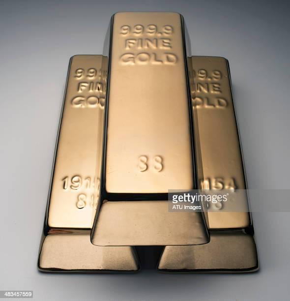 Gold bars on grey