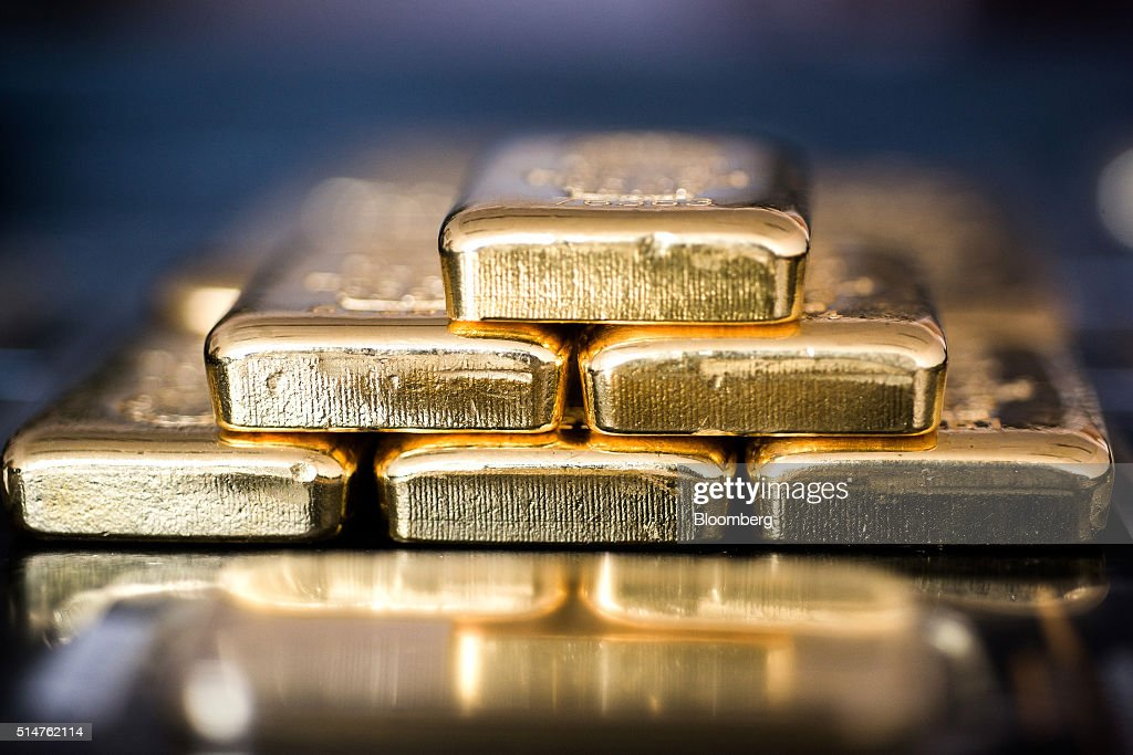 Gold bars sit stacked in this arranged photograph at Solar Capital Gold Zrt. in Budapest, Hungary, on Thursday, March 10, 2016. Gold advanced to the highest level in a year after the European Central Bank indicated it wouldn't cut interest rates further, boosting the euro and making dollar-denominated bullion less expensive for investors. Photographer: Akos Stiller/Bloomberg via Getty Images