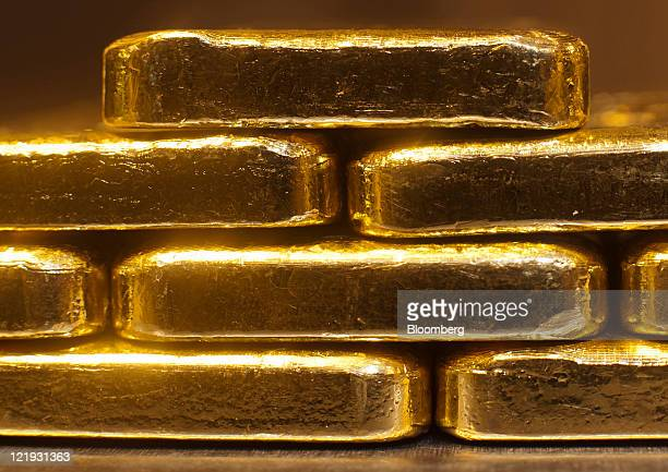 Gold bars weighing one kilogram each sit on a table in the vault of gold vendor ProAurum in Munich Germany on Tuesday Aug 23 2011 Gold advanced to an...