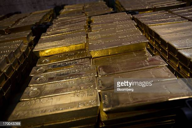 Gold bars worth hundreds of thousands of dollars each sit in a vault at the United States Mint at West Point in West Point New York US on Wednesday...