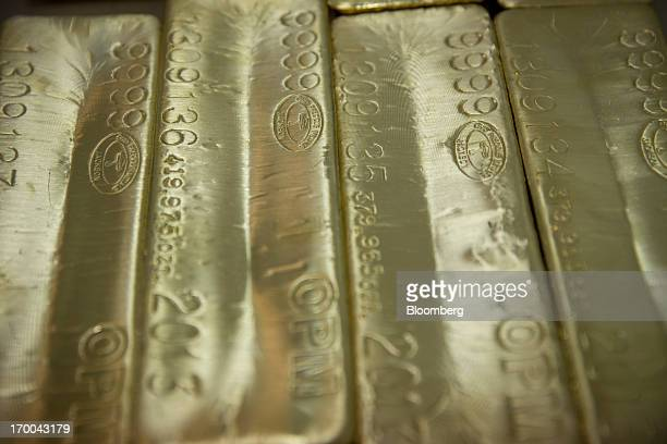Gold bars worth several hundreds of thousands of dollars sit on a table at the United States Mint at West Point in West Point New York US on...