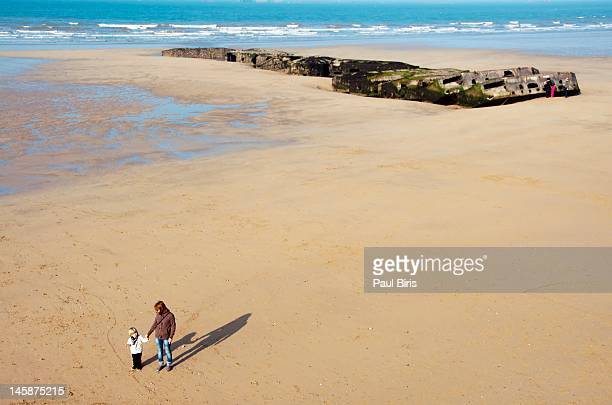 gold beach site of mulberry harbour - arromanches stock pictures, royalty-free photos & images
