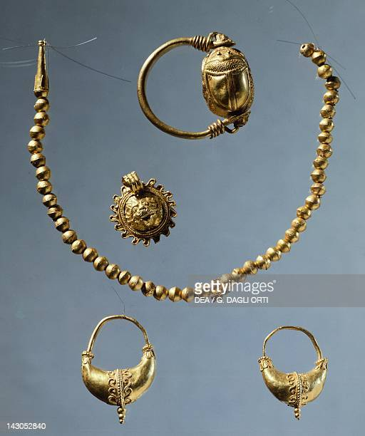 Gold bead necklace scarab ring earrings and a gold crown Goldsmith art Greek Civilization Taranto Museo Archeologico Nazionale