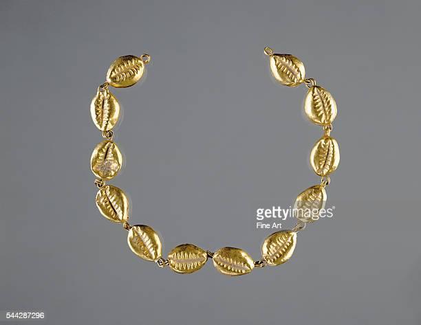 Gold Beads in the Shape of Cowrie Shells, 220-100 B.C., gold, Roman Egypt, 17 cm long, The J. Paul Getty Museum, Malibu, California.