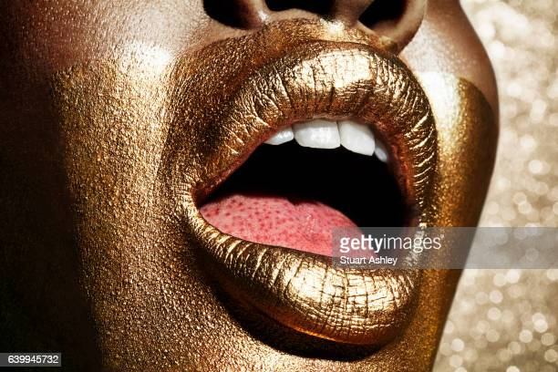 gold beautiful mouth and lips - body paint stock pictures, royalty-free photos & images