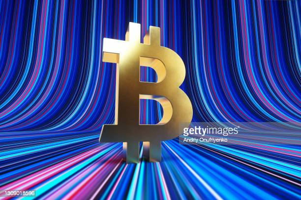 Gold Bitcoin sign standing on stripped background.