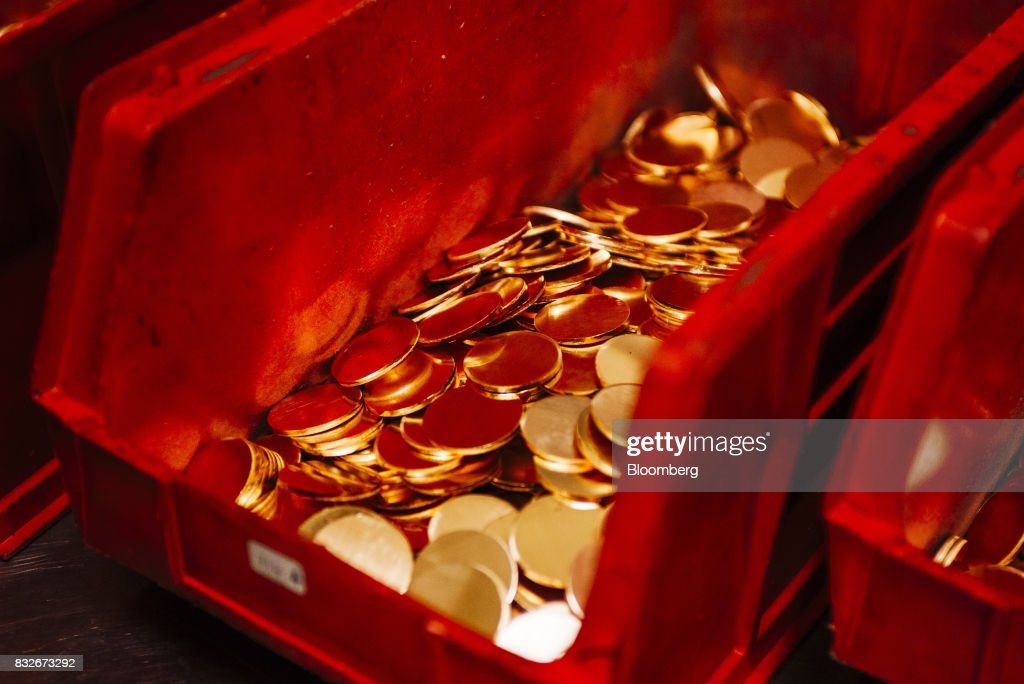 Gold blanks for krugerrand coins sit in a collection bin before delivery to the South African mint for stamping at the Rand Refinery Ltd. plant in Germiston, South Africa, on Wednesday, Aug. 16. 2017. Established by the Chamber of Mines of South Africa in 1920, Rand Refinery is the largest integrated single-site precious metals refining and smelting complex in the world, according to their website. Photographer: Waldo Swiegers/Bloomberg via Getty Images