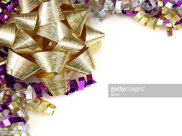 gold bow and colorful ribbons - mardi gras flashing stock photos and pictures