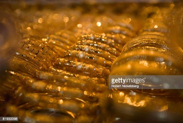 Gold bracelets and bangles are displayed in a shop front on February 28 2007 in Kadhimiya Baghdad Iraq's main gold market The gold market is adjacent...