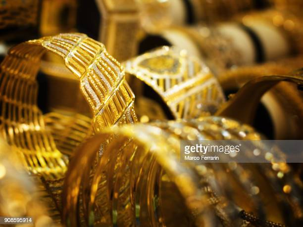gold bracelets for sale at gold souk in dubai, united arab emirates - jewellery products stock photos and pictures