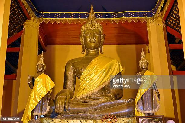 gold buddha at Wat Ong Teu buddhism temple Vientiane Laos