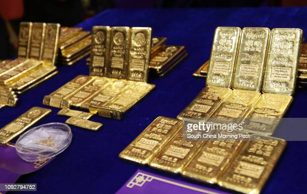 Gold bullion are seen at opening ceremony on debut of Year of Rooster and accreditation ceremony of three new gold refineries at The Chinese Gold and...