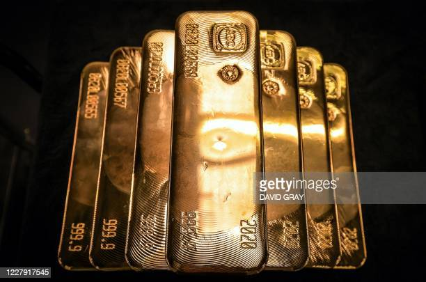 Gold bullion bars are pictured after being inspected and polished at the ABC Refinery in Sydney on August 5 2020 Gold prices hit 2000 USD an ounce on...