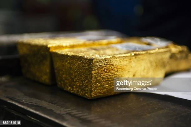 Gold bullion bars sit following casting at a refinery