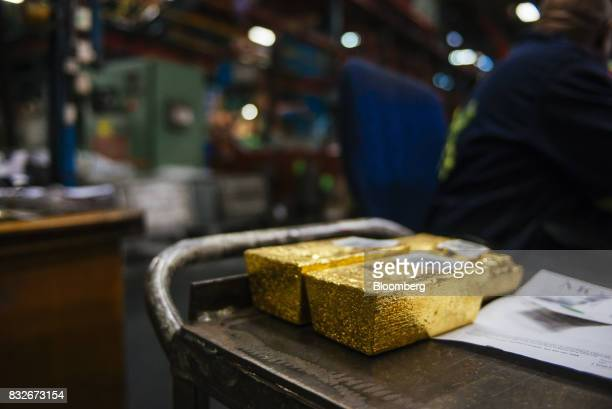 Gold bullion bars sit following casting at the Rand Refinery Ltd plant in Germiston South Africa on Wednesday Aug 16 2017 Established by the Chamber...