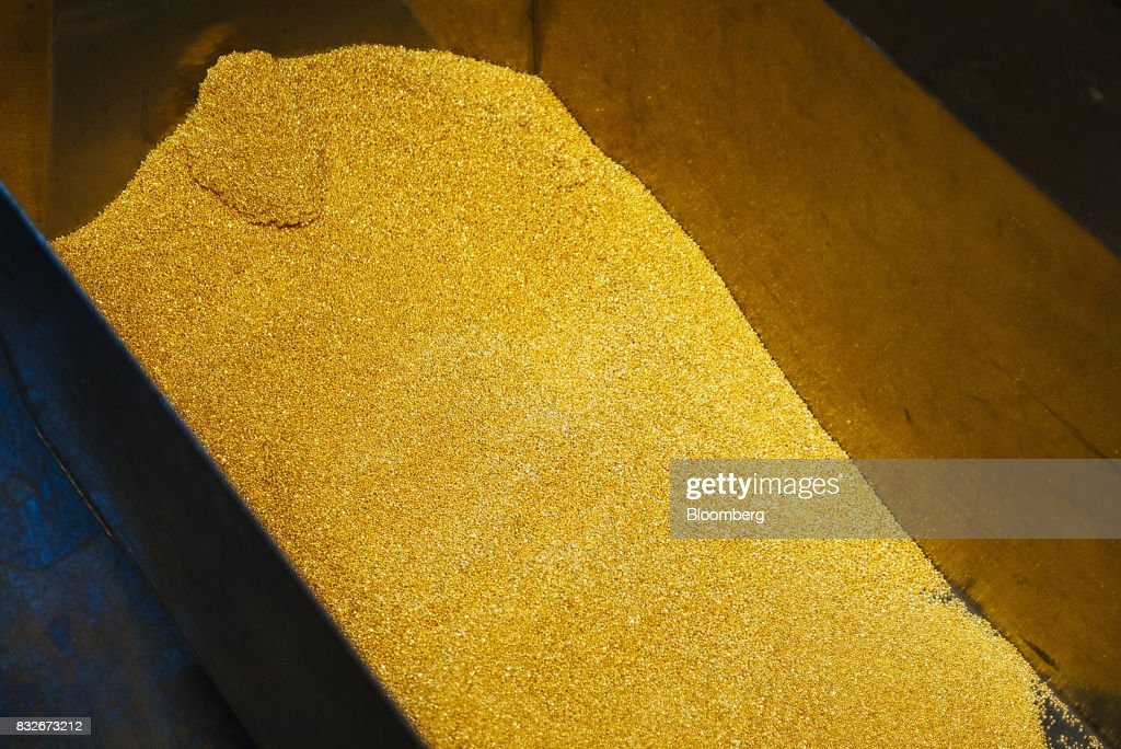 Gold bullion granules sit in a container at the Rand Refinery Ltd. plant in Germiston, South Africa, on Wednesday, Aug. 16. 2017. Established by the Chamber of Mines of South Africa in 1920, Rand Refinery is the largest integrated single-site precious metals refining and smelting complex in the world, according to their website. Photographer: Waldo Swiegers/Bloomberg via Getty Images