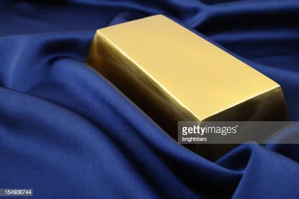 Gold bullion on blue satin