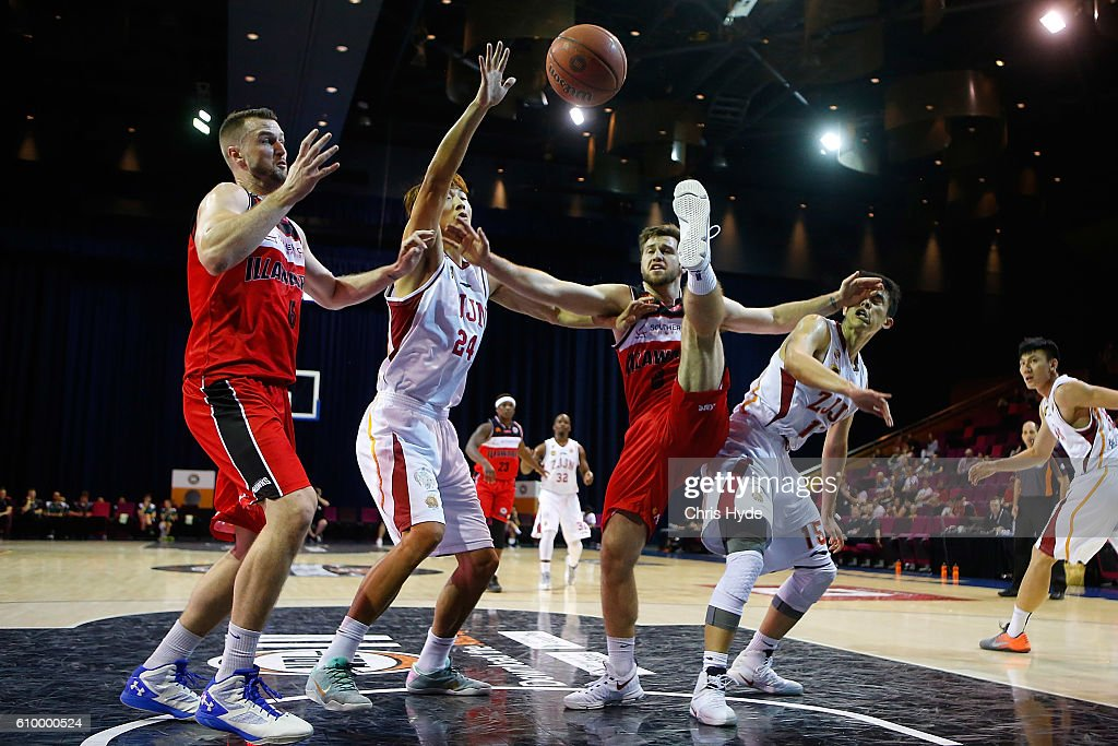 Gold Bulls and Hawks compete for the ball during the Australian Basketball Challenge match between Zhejiang Gold Bulls and Illawarra Hawks at the Brisbane Convention and Exhibition Centre September 24, 2016 in Brisbane, Australia.