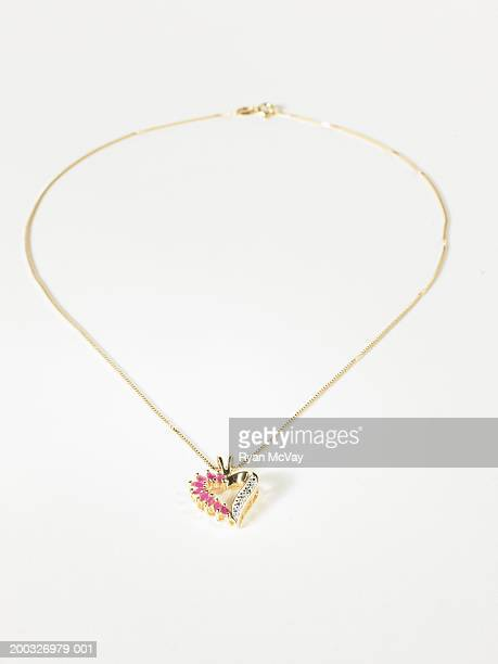 Gold chain with heart-shaped pendant, elevated view