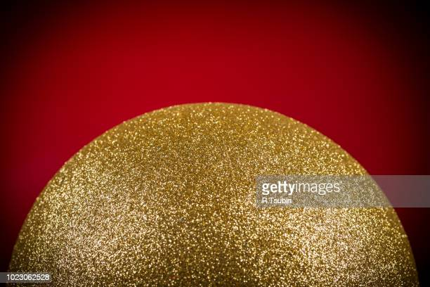 gold christmas ball and christmas decorations on red background - gold dress stock pictures, royalty-free photos & images