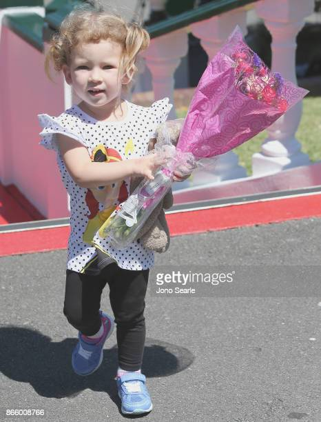 Gold Coast girl Isabella Kennedy arrives to place flowers at the entrance to Dreamworld on October 25 2017 in Gold Coast Australia Four people were...