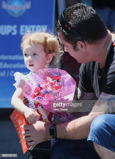 Gold Coast girl Isabella Kennedy arrives with her dad to place flowers at the entrance to Dreamworld on October 25 2017 in Gold Coast Australia Four...