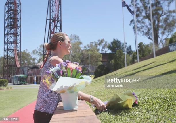 Gold Coast local Amanda Bonney arrives to place flowers at the entrance to Dreamworld on October 25 2017 in Gold Coast Australia Four people were...