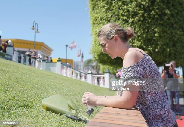 Gold Coast local Amanda Bonney has a monent after placing flowers at the entrance to Dreamworld on October 25 2017 in Gold Coast Australia Four...