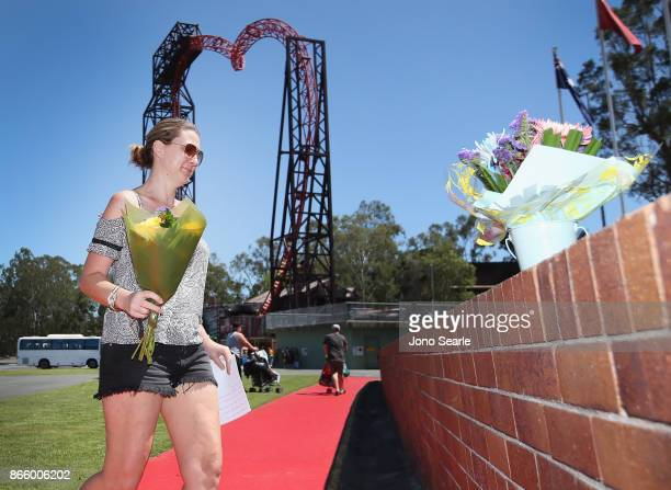 Gold Coast local Amanda Bonney places flowers at the entrance to Dreamworld on October 25 2017 in Gold Coast Australia Four people were killed...