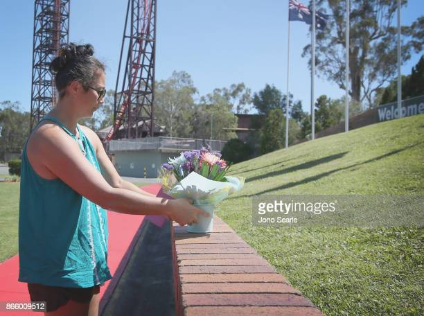 Gold Coast local Rea Lust places flowers at the entrance to Dreamworld on October 25 2017 in Gold Coast Australia Four people were killed following...