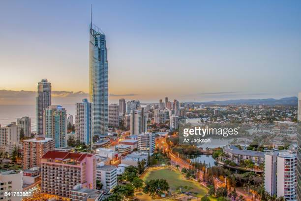gold coast skyline at twilight - gold coast queensland stock pictures, royalty-free photos & images