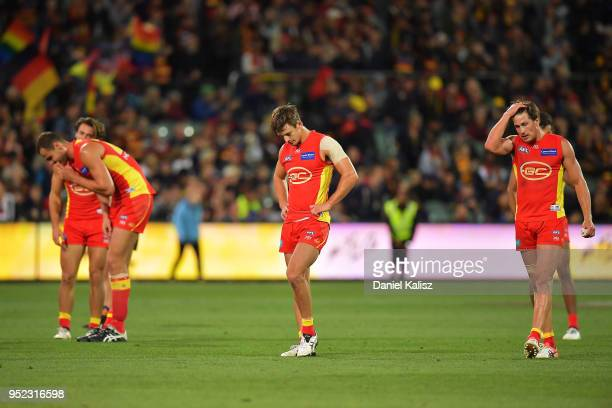 Gold Coast Suns players look on dejected after the final siren during the round six AFL match between the Adelaide Crows and Gold Coast Suns at...