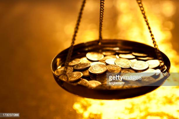 Gold coins on a weight scale