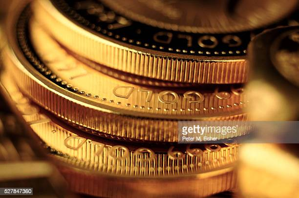 gold coins - capitalism stock pictures, royalty-free photos & images