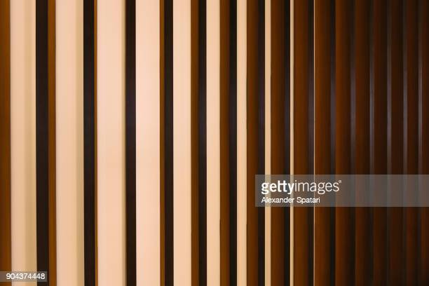 Gold colored abstract striped architectural detail