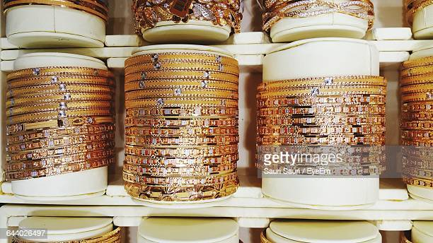 Gold Colored Bangles Arranged In Jewelry Store For Sale