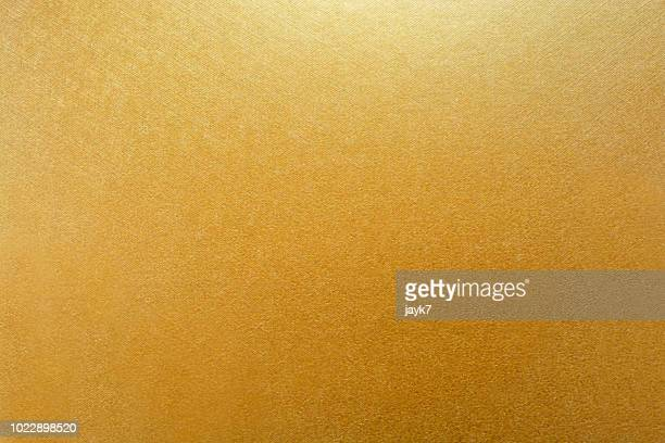 gold colored paper background - gold colored stock pictures, royalty-free photos & images