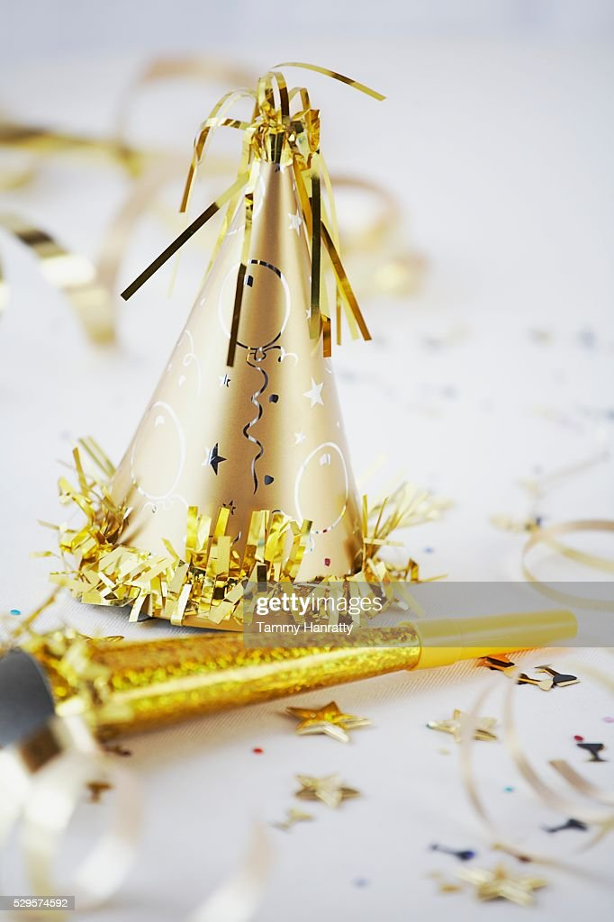 Gold Colored Party Hat and Noisemaker : Stock Photo