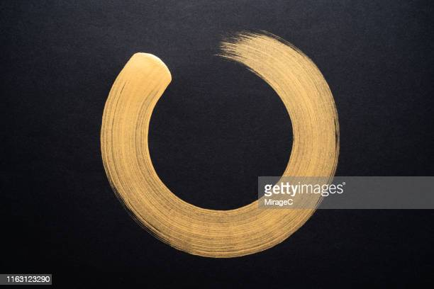 gold colored sumi circle - design element stock pictures, royalty-free photos & images