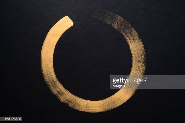 gold colored sumi circle - circle stock pictures, royalty-free photos & images