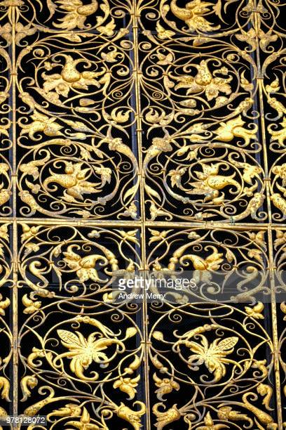 gold coloured decorative screen on large window on the clock tower of st. vitus cathedral, prague - st vitus's cathedral stock pictures, royalty-free photos & images