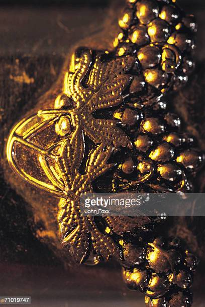 gold coloured ornament - christmas background stock photos and pictures