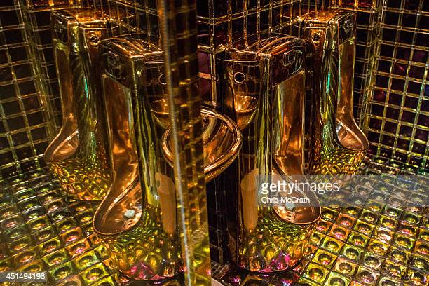 Gold coloured urinals are seen in the men's bathroom at The Robot Restaurant on June 29 2014 in Tokyo Japan The now famous Robot Restaurant opened...