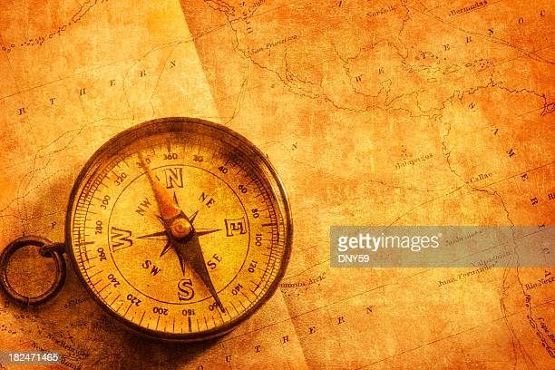 Gold Compass Sitting On An Old Map