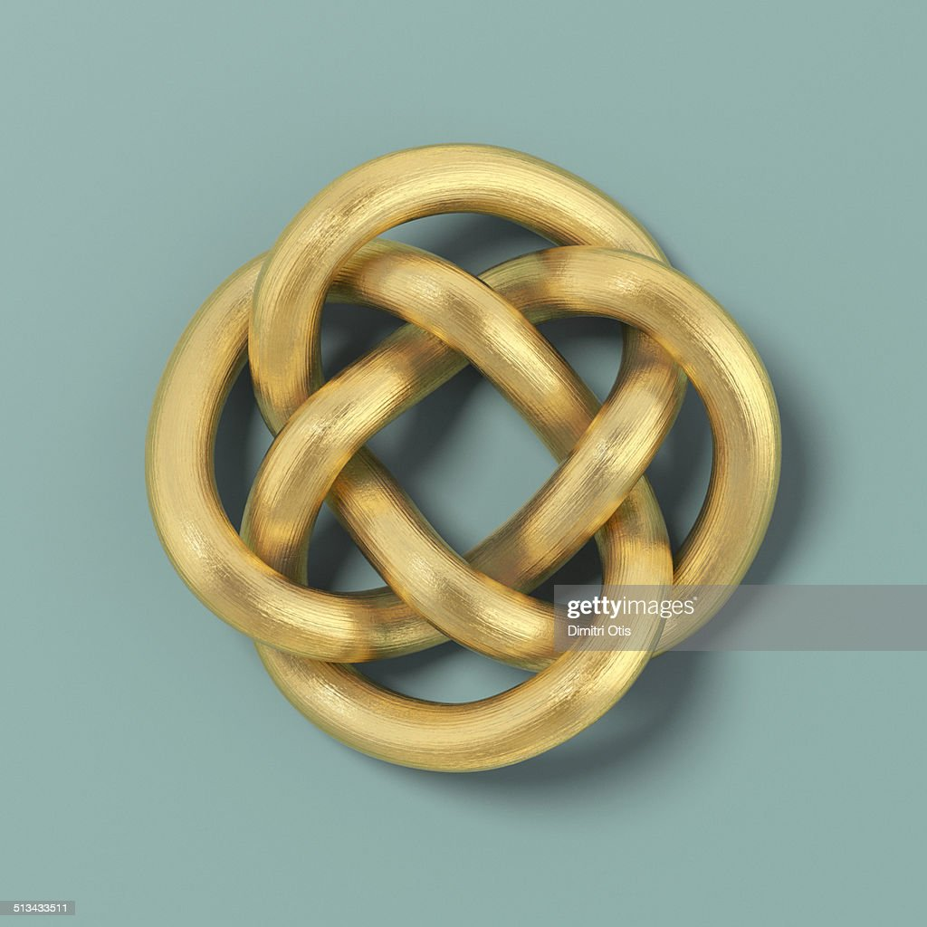 Gold cord forming a Keltic infinity knot : Stock Photo